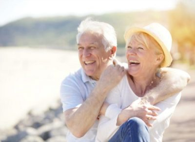 Happy Elder Couple at the Beach
