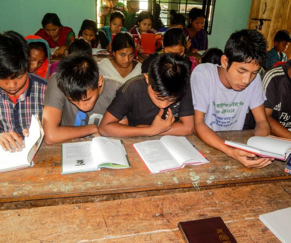 Children of the Hills Students studying books
